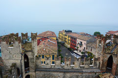 View from one of old castle tower of the roofs of nice town Sirmione on Lake Garda, Italy, foggy day, november 2016 Royalty Free Stock Images