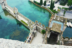 View from one of old castle tower of the roofs of nice town Sirmione on Lake Garda, Italy, foggy day, november 2016 Stock Image