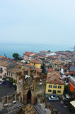 View from one of old castle tower of the roofs of nice town Sirmione on Lake Garda, Italy, foggy day, november 2016 Royalty Free Stock Photo