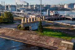 View of one part of Saint-Petersburgs harbour. View of the entrance to Saint-Petersburgs harbour with ships under loading and wellknown city buildings on the royalty free stock photography