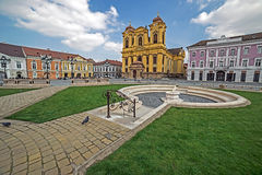 View of one part at Union Square in Timisoara, Romania, with old buildings. TIMISOARA, ROMANIA - MARCH 18, 2016: View of one part at Union Square in Timisoara Royalty Free Stock Images