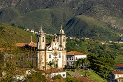 View of one of several churches of Ouro Preto. View of one of several churches and your bell tower in baroque and colonial architecture of the city of Ouro Preto royalty free stock images
