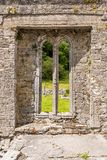 A view of one of the windows of the abanoned ruins of Killone Abbey that was built in 1190 and sits on the banks of the Killone. Lake, just outside Ennis stock photography