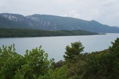 View onto the hills and still water in foggy morning near Neum. Bosnia Herzegovina. Purposely blurred, selective focus Royalty Free Stock Photo