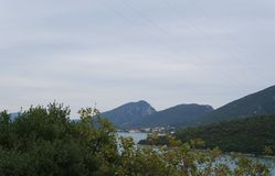 View onto the hills and still water near Neum. View onto the hills and still water in foggy morning near Neum, Bosnia Herzegovina Royalty Free Stock Images