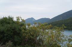 View onto the hills and still water near Neum. View onto the hills and still water in foggy morning near Neum, Bosnia Herzegovina Royalty Free Stock Photo