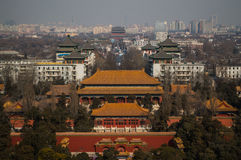 View onto Jutaposition of Temples and Modern Buildings seen from Jingshan Park Hill, Beijing, China. View onto Jutaposition of Temples and Modern Buildings seen royalty free stock photography
