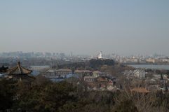 View onto Jutaposition of Temples and Modern Buildings seen from Jingshan Park Hill, Beijing, China. View onto Jutaposition of Temples and Modern Buildings seen royalty free stock image