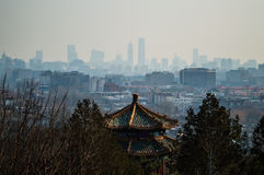 View onto Jutaposition of Temples and Modern Buildings seen from Jingshan Park Hill, Beijing, China. View onto Jutaposition of Temples and Modern Buildings seen stock photos