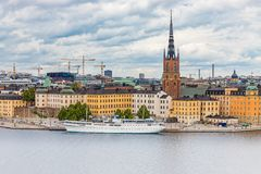 View onto Riddarholmen island in Stockholm old town Gamla Stan i. View onto Riddarholmen island and Riddarholmen church, the burial church of Swedish monarchs royalty free stock images