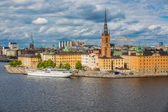 View onto Riddarholmen island in Stockholm old town Gamla Stan i. View onto Riddarholmen island and Riddarholmen church, the burial church of Swedish monarchs royalty free stock photography