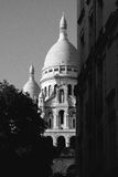 View onto Sacre Coeur from Montmartre. The church Sacre Coeur in France's capital Paris seen from the base in the famous quartier Montmartre Stock Photos