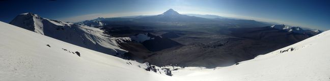 View onto Sajama volcano from Parinacota Volcano Stock Image