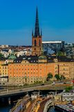 View onto Stockholm old town Gamla Stan and Riddarholmen church. Traditional gothic buildings in the old town, Gamla Stan in and Riddarholmen church, the burial Royalty Free Stock Photo