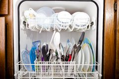 View of the open dishwasher Royalty Free Stock Images