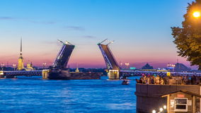 View of the open Palace Bridge timelapse, which spans - the spire of Peter and Paul Fortress. Classic symbol of St. Petersburg White Nights - a romantic view of stock video