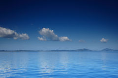 View of an open sea with a cloud on Corfu island Royalty Free Stock Photography