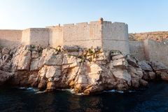 View from the open sea to the city walls of Dubrovnik Royalty Free Stock Images