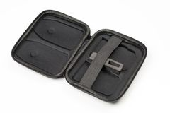 View of opened black case for two batteries for drone on white background. View of opened black hard carrying case for two Lipo batteries for drone on white stock photography