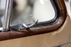 View on opened front door with chrome handle for opening the corner window of the old Russian car of the executive class. Released royalty free stock images