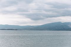 View opening onto the Chirkei reservoir from the shore. Mountains in the background of the cloudy sky. Sulak Canyon, Dagestan royalty free stock image
