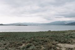 View opening onto the Chirkei reservoir from the shore. Mountains in the background of the cloudy sky. Sulak Canyon, Dagestan royalty free stock images