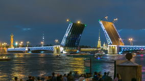 View of the opening Palace Bridge timelapse, which spans between - the spire of Peter and Paul Fortress. Classic symbol of St. Petersburg White Nights - a stock video footage
