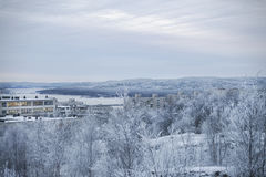 View opens with a snow-covered hill. In the mountains, the city and the bay Stock Photo
