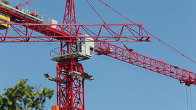 View of operating crane engine pulling hook against clouds stock video footage