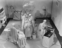 View of operating room from above. (All persons depicted are no longer living and no estate exists. Supplier grants that there will be no model release issues Royalty Free Stock Images