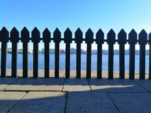 View of the opposite shore through the  fence royalty free stock image