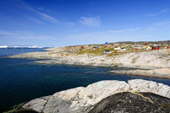 View of Oqaatsut Settlement (Rodebay). Oqaatsut, formerly Rodebay, is a settlement in the Qaasuitsup municipality, in western Greenland. It had 46 inhabitants in Royalty Free Stock Images