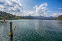 View of Orta Lake Lago d`Orta, Italy. Lake Orta or Cusio is a `pre-Alpine` water lake located between the provinces of Novara an stock photos