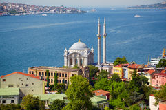 The view of Ortakoy Mosque against the Bosphorus background.  Is Stock Photography