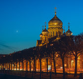 View of Orthodox Church at night with lights, the metochion of Optina Hermitage in St. Petersburg Stock Photography