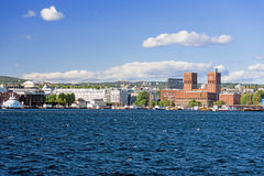View of Oslo Town Hall  and Aker Brygge from the sea Royalty Free Stock Photo
