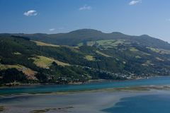 A view from the Otago Peninsula across the sea near Dunedin in the South Island in New Zealand. A view from the Otago Peninsula across the sea near Dunedin in royalty free stock image