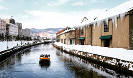 View of Otaru Canel in Winter season with signature tourist boat Royalty Free Stock Photo