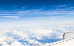 View out of an aircraft's window at high altitude. Aircraft flying at high altitude over the cloud cover royalty free stock photos