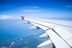 View out of airplane Airplane wing in flight Royalty Free Stock Photography