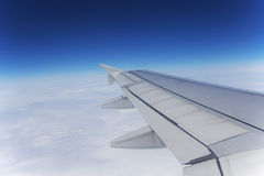 View out of airplane wing in flight Royalty Free Stock Photography