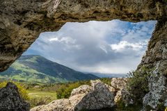 Moutains and cave Royalty Free Stock Photo