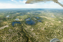 Flight over flooded parts in Botswana. View out of a plane over flooded parts in Botswana royalty free stock image