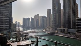 View out of a restaurant in Dubai marina mall. Dubai marina mall external restaurant marina view Stock Photo