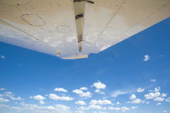 View out of a small plane in to the blue sky Royalty Free Stock Image