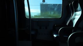 View out from a Window of a Train. View of seats from a Window of a Regional Italian Train stock video footage