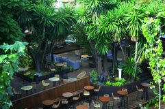 Outdoor restaurant with green trees, summer royalty free stock photography