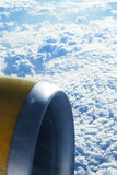 View outside from a plane. A piece from the plane is visible Royalty Free Stock Image