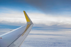 View outside the plane window. Photo of airplane wing outside the plane window Royalty Free Stock Photos