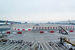 Airplanes stationed and taxiing at Brussels Airport. A view over the airport and the terminals with different planes stationed or taxiing to the runway at Royalty Free Stock Image